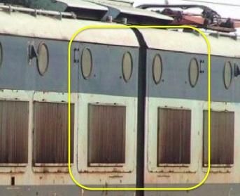 Fiancata di una seconda serie (237). I portelloni centrali sul lato AT sono alti e arrivano a comprendere le due coppie d ioblò centrali.