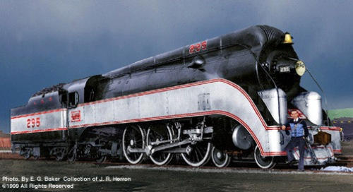 L&N 4-6-2 295, the famed South Wind locomotive. Photographer E. G. Baker poses at the front. A B&W photo retouched and colorized by Jim Herron. Da www.herronrail.com
